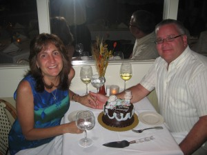 Barbara and David Thompson celebrating their 25th wedding anniversary on Sanibel Island at Casa Ybel's Thistle Lodge Beachfront Restaurant